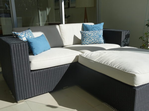 Amalfi Steel Blue and Steel Blue Sunbrella outdoor cushions on couch