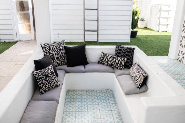 Black Sunbrella ranges on white bench seat