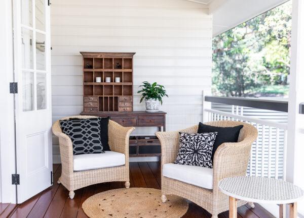 Black Sunbrella ranges on chairs under verandah