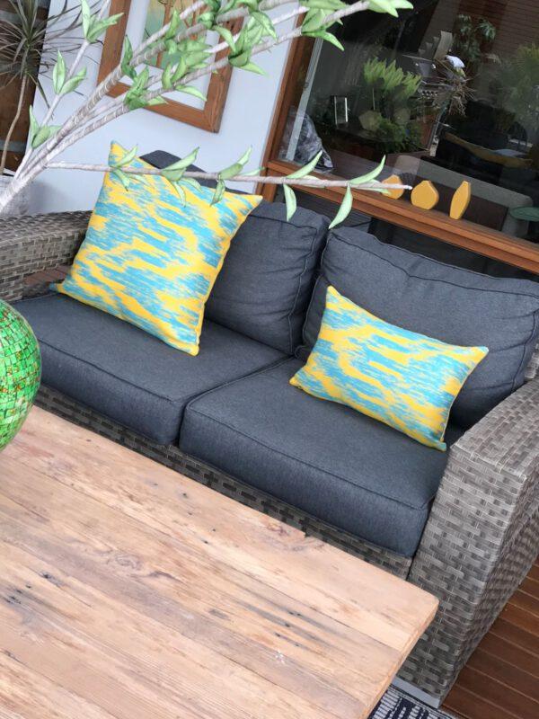Legian Yellow Sunbrella outdoor cushions on wicker couch