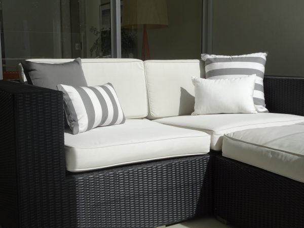 Positano Grey, Off White and Charcoal Grey Sunbrella outdoor cushions on couch