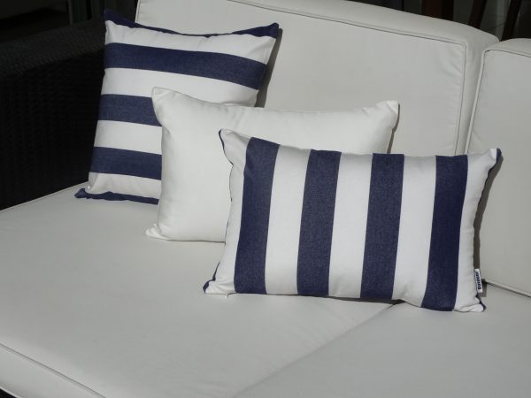 Positano Navy 30x45cm vertical and 40x40cm on white couch