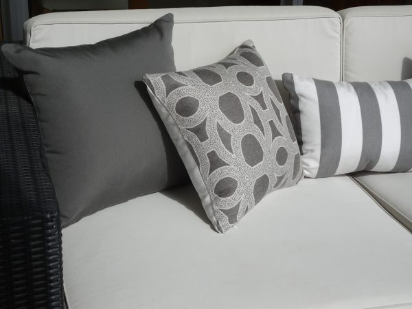 Charcoal Grey Seychelles Grey Positano Grey Sunbrella outdoor cushions on outdoor couch