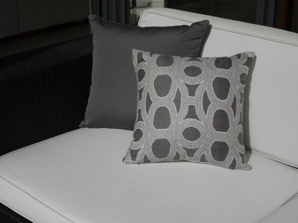 Charcoal grey and Seychelles Grey Sunbrella outdoor cushions on couch