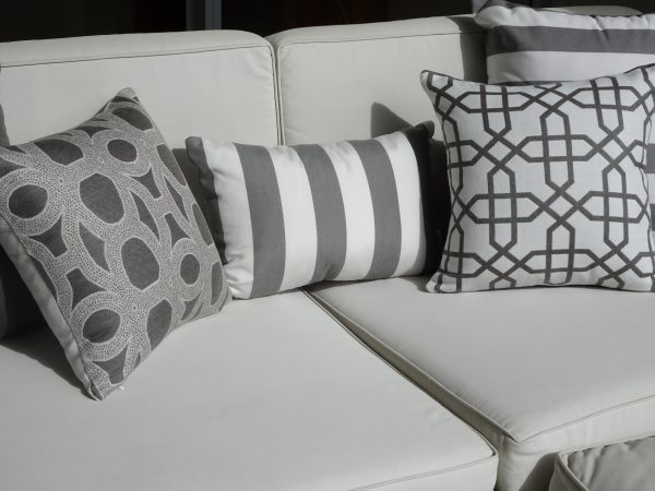 Positano Grey Naxos Grey and Seychelles Grey on outdoor couch