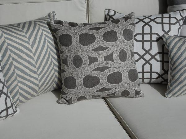 Seychelles Grey Zimbali Grey Naxos Grey Sunbrella outdoor cushions on couch