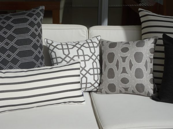 Navajo Grey Biarritz Black Seychelles Grey Loft Grey Sunbrella outdoor cushions on couch