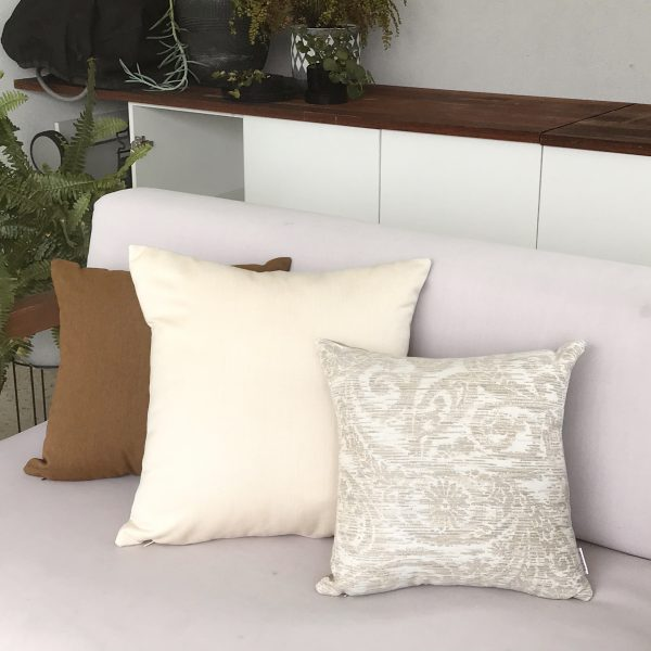 Chennai Heather Beige and Cream and Teak on couch Sunbrella outdoor cushions from Outdoor Interiors
