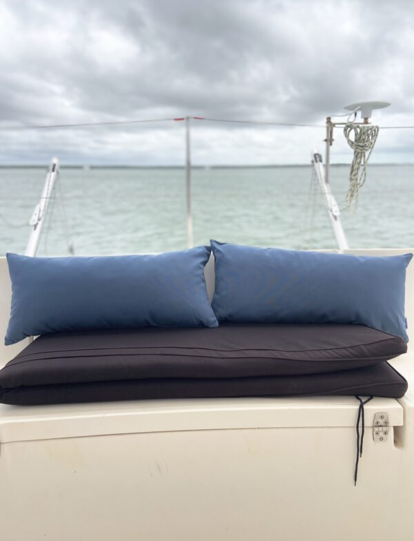 Blue Sunbrella 30cm x 65cm fade and water resistant outdoor cushion on boat