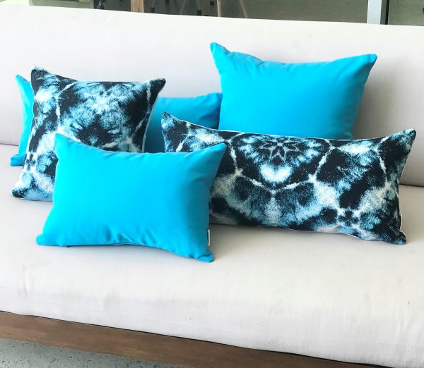Santorini Blue and Cyan Blue group on lounge Sunbrella outdoor cushions from Outdoor Interiors